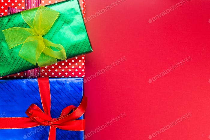 Colourful Christmas background decorated with gift boxes and rib