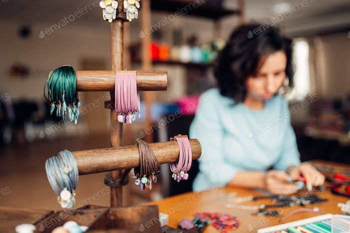 Needlework tools, master at workplace in workshop