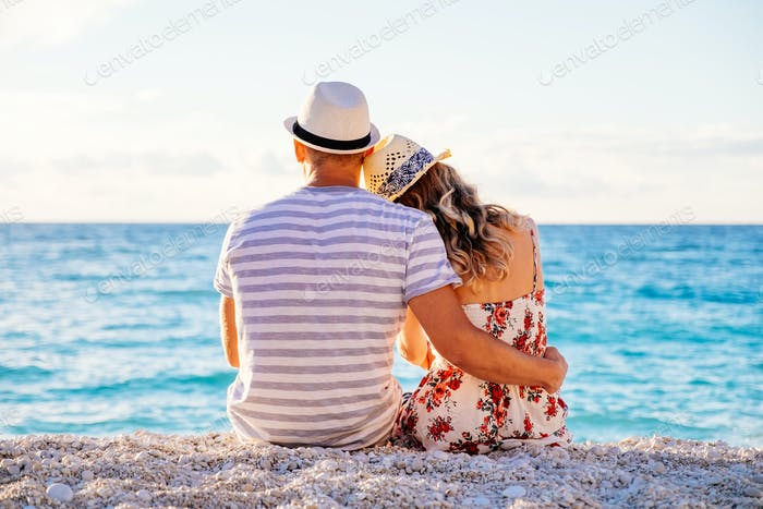Thumbnail for Young couple in love sitting on the beach