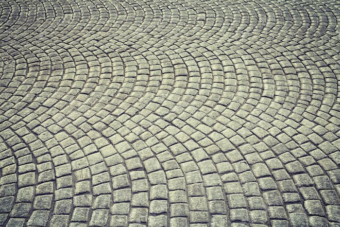 Vintage toned old cobblestone pavement background