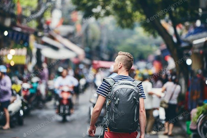 Traveler walking on busy street