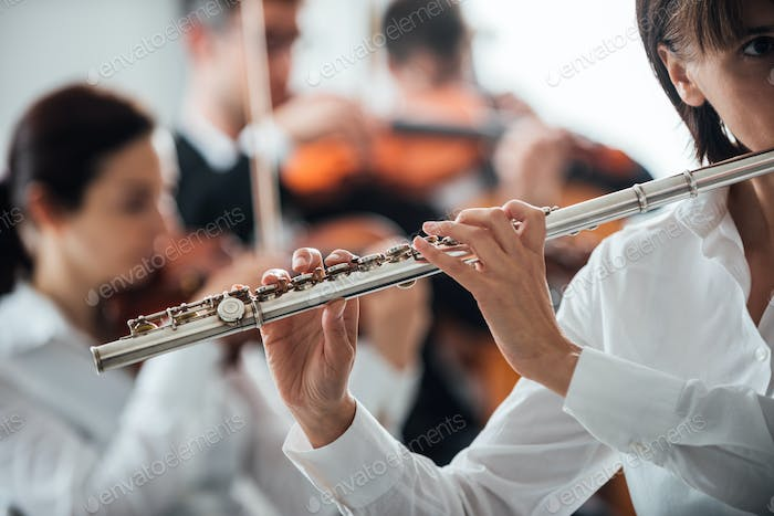 Professional flute player performing
