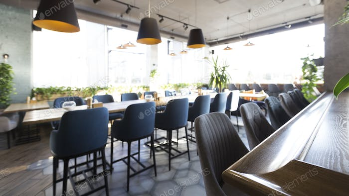 Restaurant interior with no people, chairs and big table