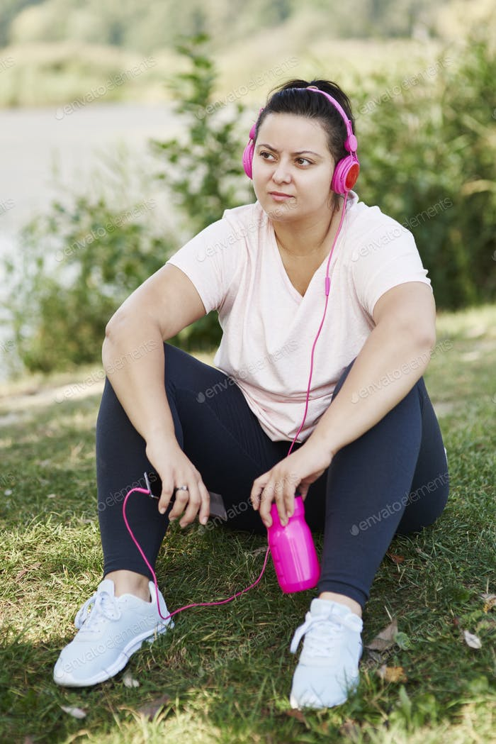 Woman resting after workout on the fresh air