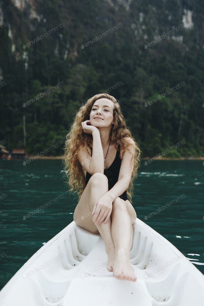 Woman relaxing on a canoe at a lake
