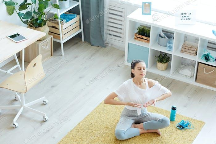 Young Woman Enjoying Home Meditation