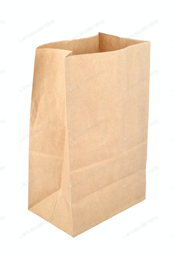 Brown empty disposable paper bag isolated on white