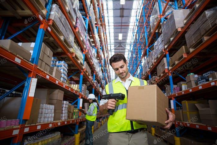 Warehouse worker using scanner