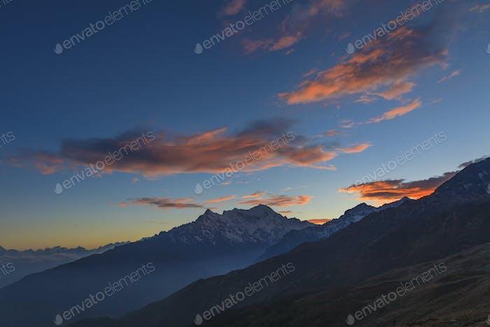 Langtang Lirung on sunset sky background