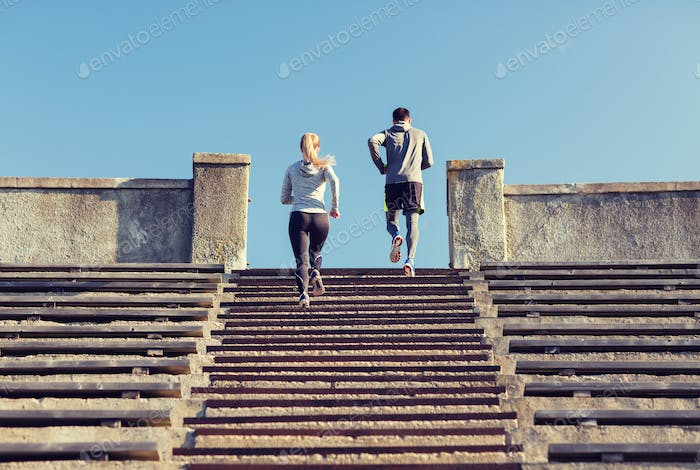 couple running upstairs on stadium