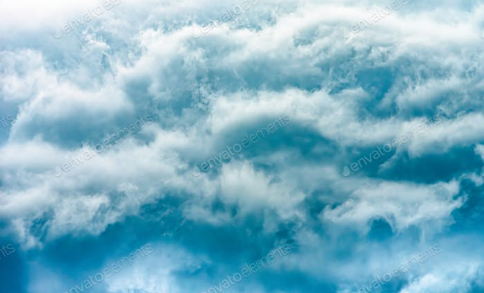 Dramatic stormy clouds, close up view on a fluffy cumulus before storm