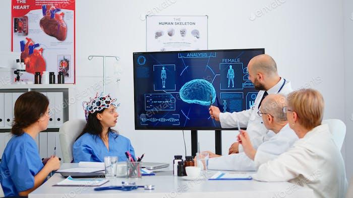 Nurse testing new innovation for brain scanning