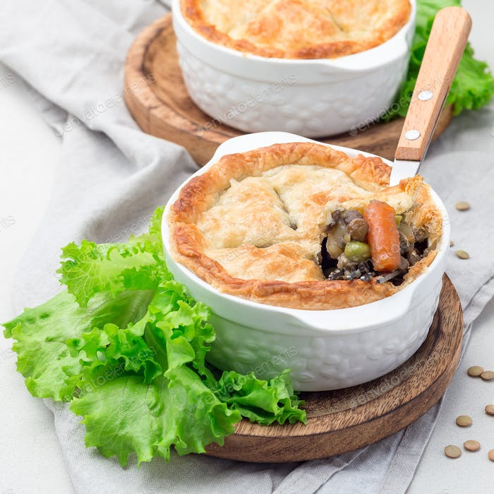Vegetarian pot pie with lentil, mushroom, potato, carrot and gre