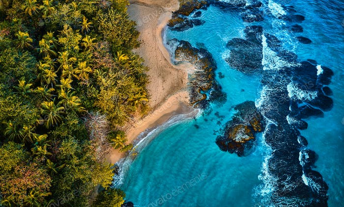 Aerial drone photo of paradise resort island with deep turquoise sea and beautiful white sand beach