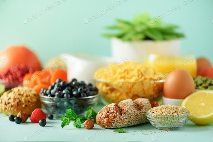 Delicious breakfast ingredients. Soft boiled egg, oat flakes, nuts, fruits, berries, milk, yogurt