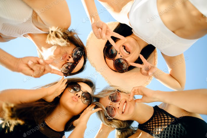 Four sexy women in sunglasses, bottom view