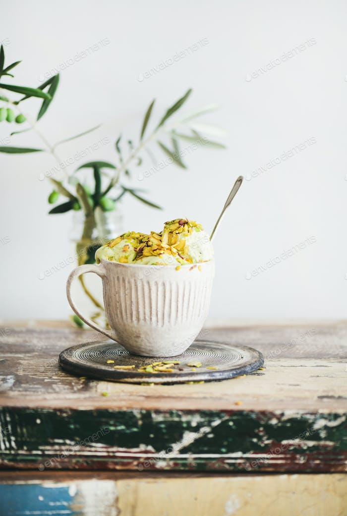 Bowl of homemade pistachio ice cream dessert in mug
