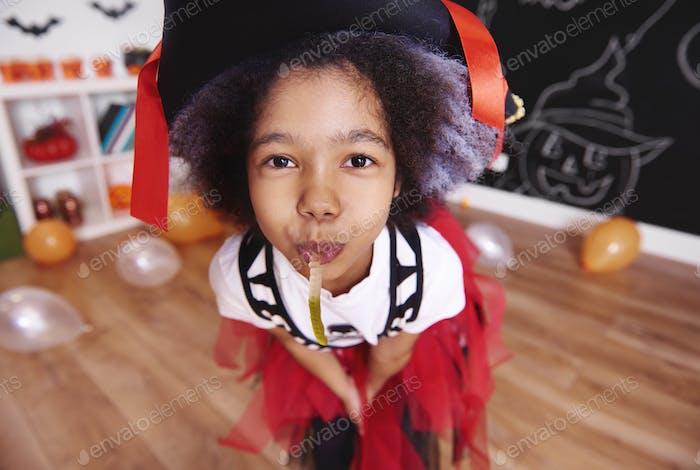 Cute girl with gummy worm posing