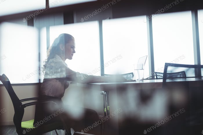 Businesswoman sitting at office cafeteria