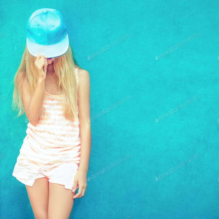 Portrait of cute teen girl in blue wall