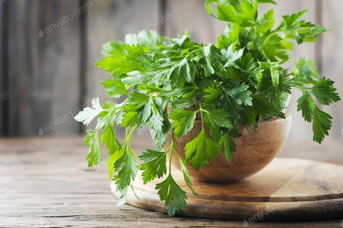 Green fresh parsley on the wooden table