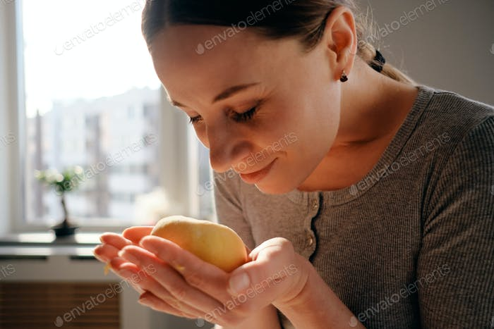 Portrait smiling woman holding dough in hands