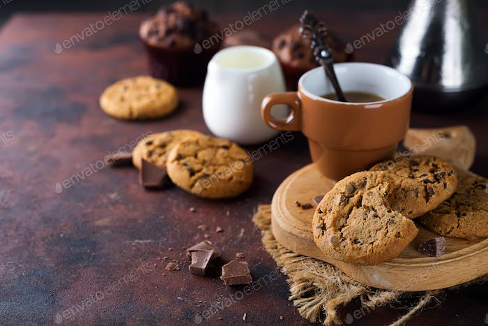 Double chocolate cookies with chips on a bowl and coffee in cup