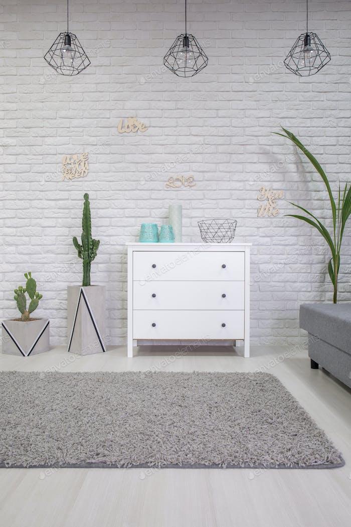 Home interior with white dresser