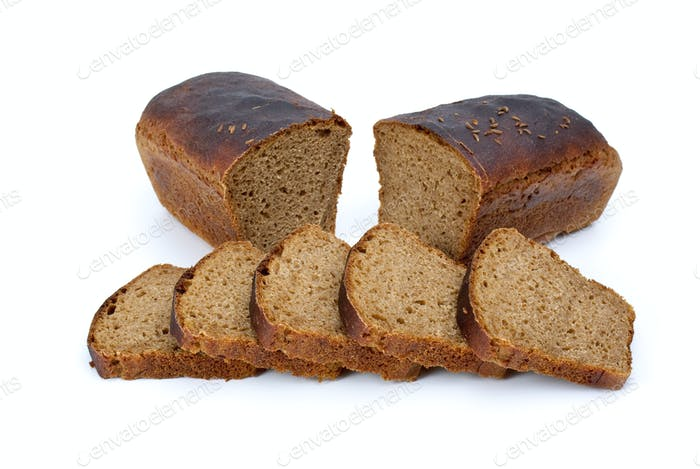 Two halves of rye bread with anise and some slices