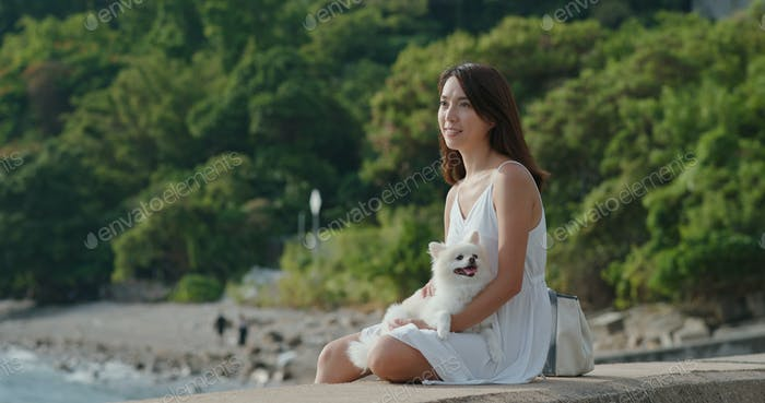 Woman enjoy sunset view with her dog