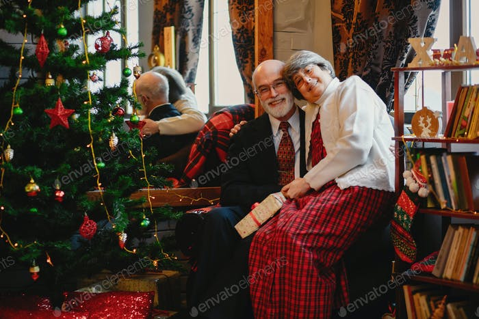 An elegant old couple are celebrating Christmas