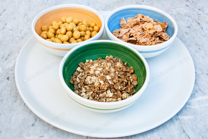 three bowls with cold breakfast cereals