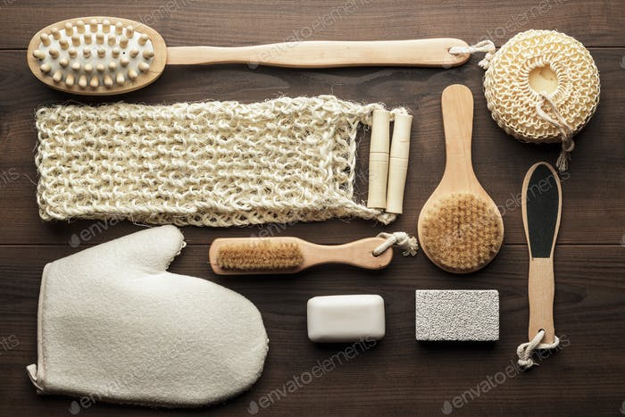 Some Bath Accessories On Brown Wooden Background