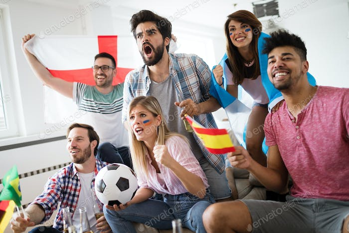 Young group of friends watching sport on television