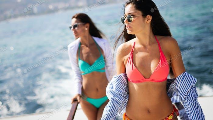 Happy women on vacation having fun on beach in summer