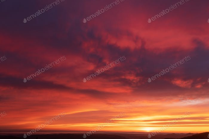Fiery purple sunset sky