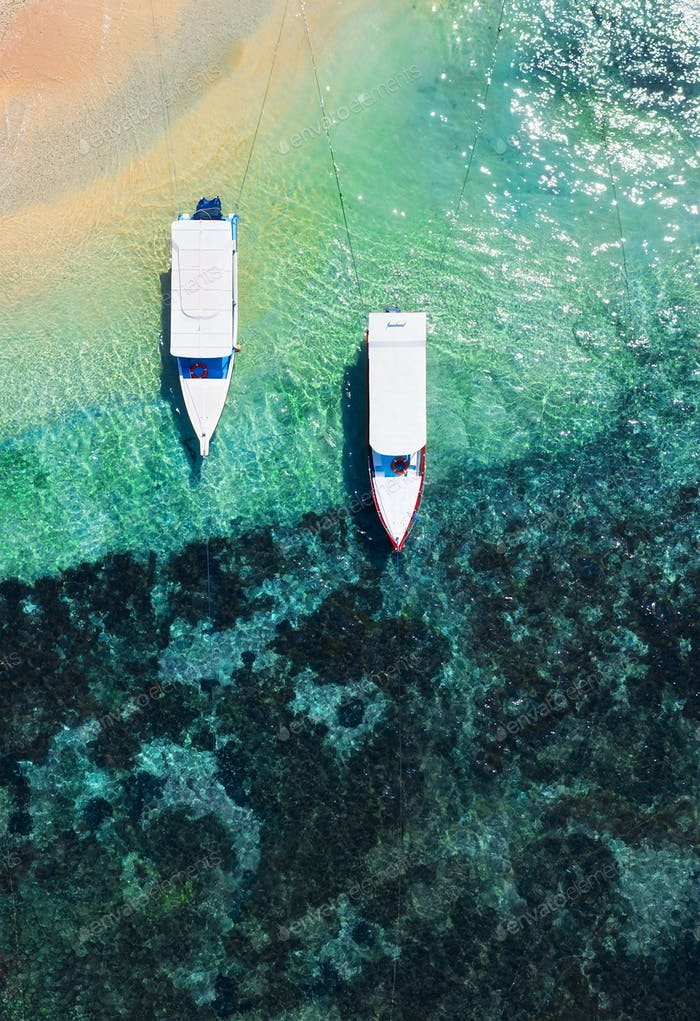 Boats on the beach from top view. Water background from drone. Bali, Indonesia.
