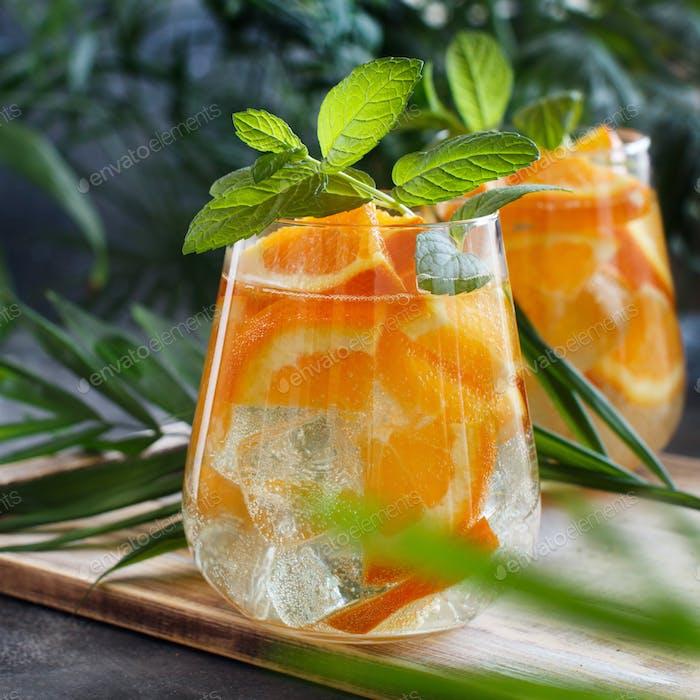 Homemade refreshing mocktail with soda and orange juice