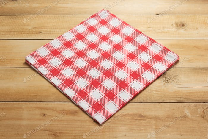 cloth napkin on at rustic wooden board table