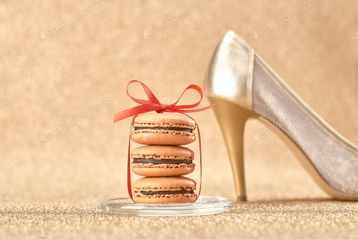Macarons. Luxury shiny shoes on gold.Vintage retro
