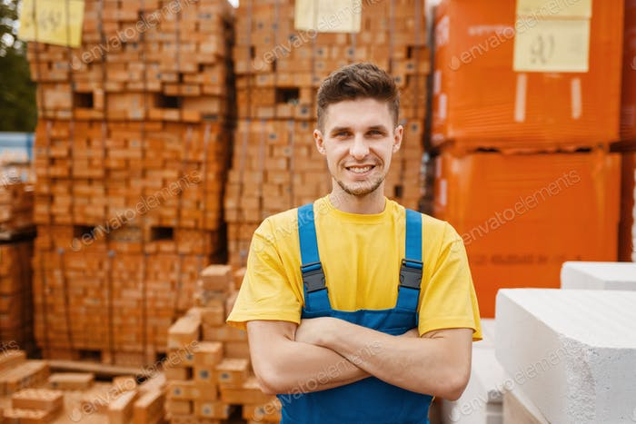 Builder at the pallets of bricks in hardware store