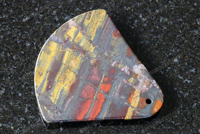 pendant from polished Jaspillite stone on black