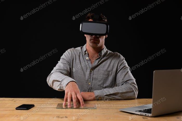 Caucasian male wearing Virtual Reality headset