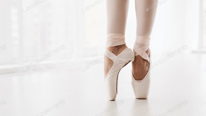 Ballerina Legs On Pointe Closeup. Classic And Modern Ballet Conc