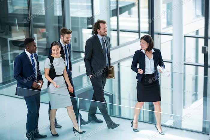 Businesswomen walking with colleagues