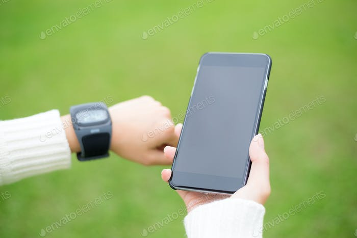 Woman use of mobile phone connect to smart phone