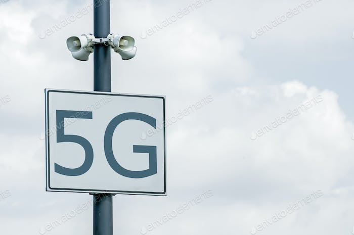 5G concept in the city. Many wireless symbols on the top of the buildings.