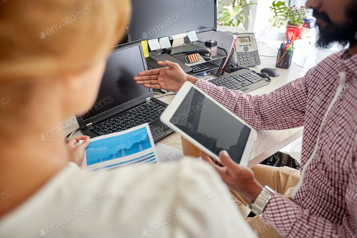 business team with laptop, chart and tablet pc