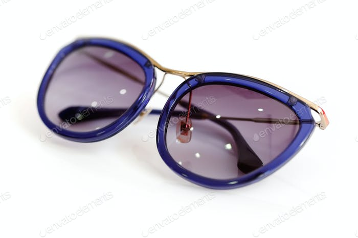 Stylish women's sunglasses on white background