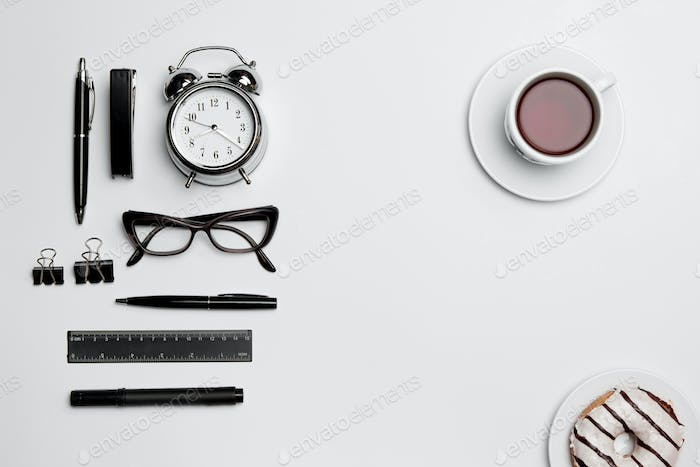 The clock, pen, and glasses on white background